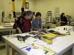 A shirt experts think was worn by Crazy Horse is inspected at the National Museum of the American Indian during my 2010 fellowship